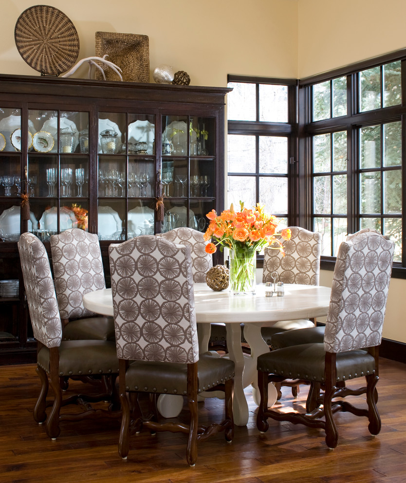 Trendy dark wood floor dining room photo in Denver with beige walls