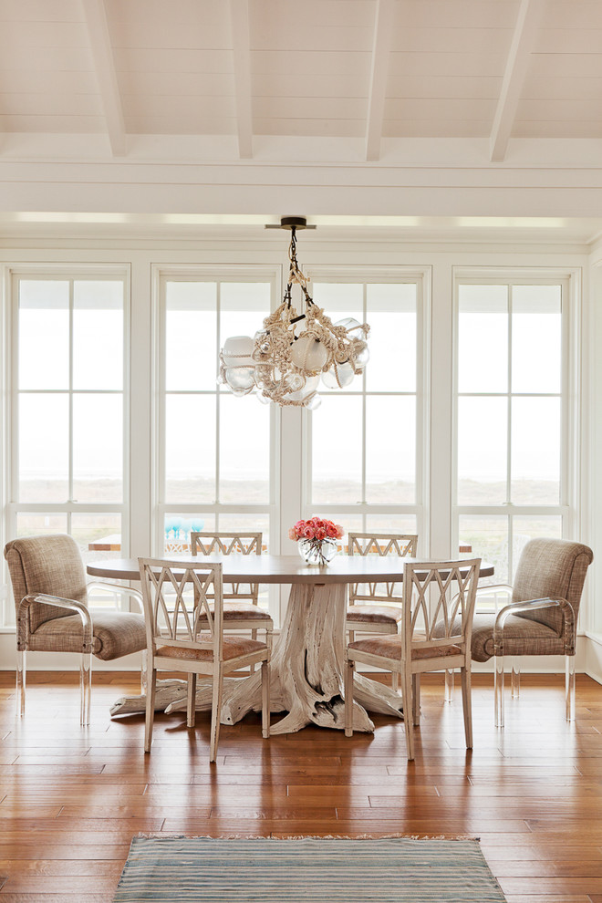 Inspiration for a coastal medium tone wood floor dining room remodel in Charleston