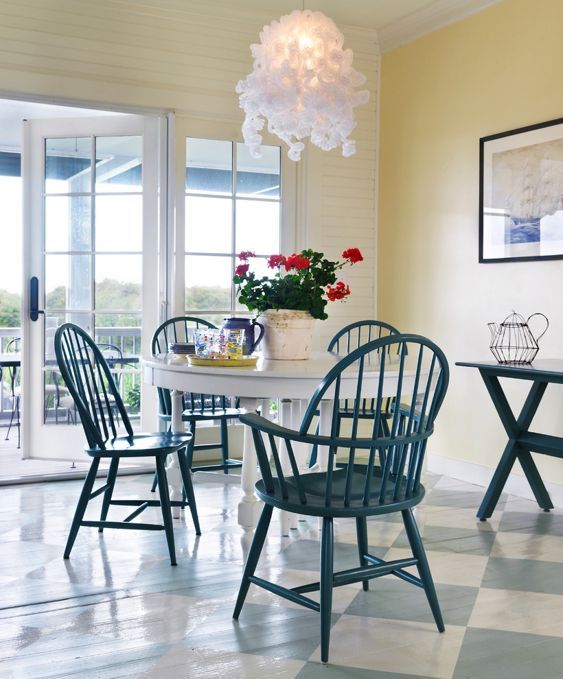 Inspiration for a coastal painted wood floor dining room remodel in Providence with yellow walls