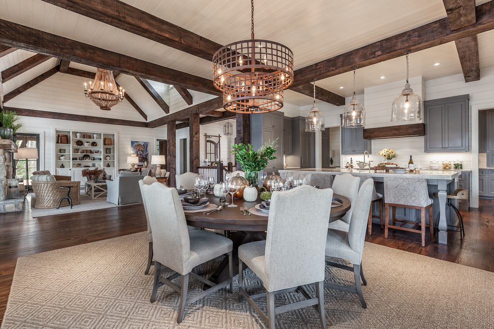 Great room - large country dark wood floor great room idea in Other with white walls and no fireplace