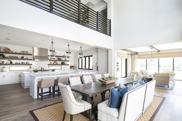 Example of a coastal medium tone wood floor great room design in San Diego with white walls and no fireplace