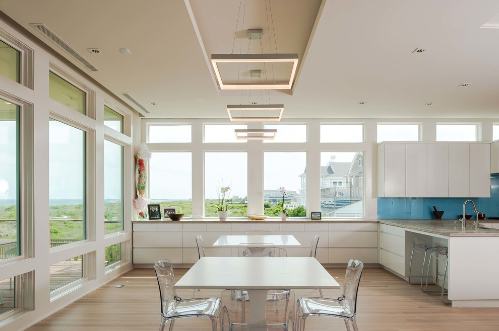 Example of a large beach style kitchen/dining room combo design in Wilmington with white walls