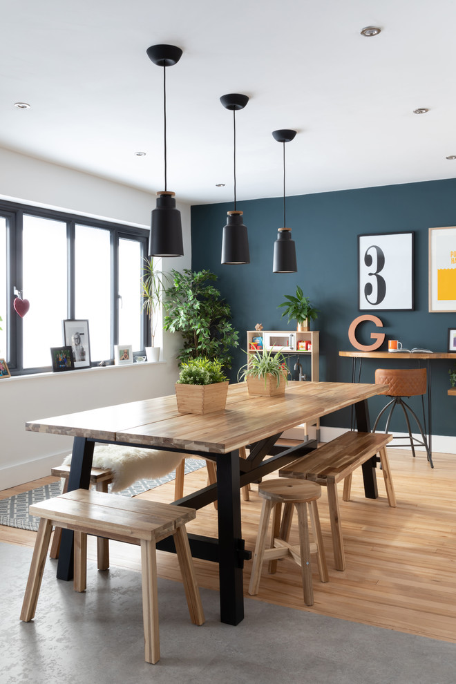 Inspiration for a scandinavian light wood floor and beige floor kitchen/dining room combo remodel in Other with white walls