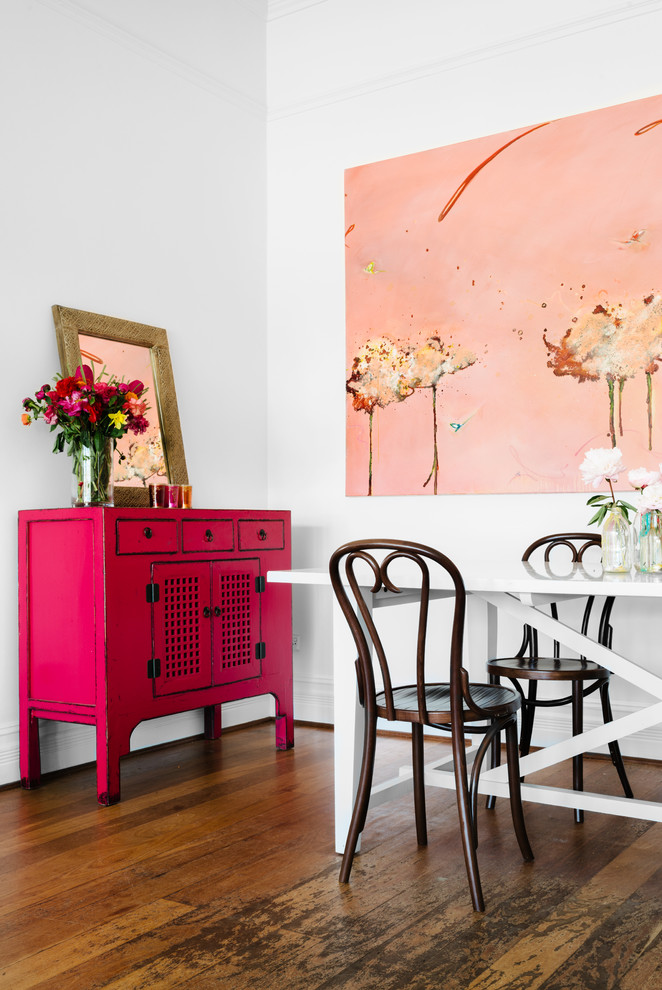 Eclectic dining room in Perth with white walls.