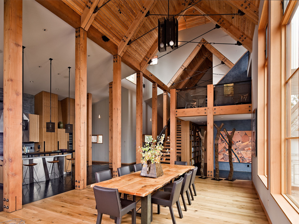 Inspiration for a rustic medium tone wood floor kitchen/dining room combo remodel in San Francisco with white walls