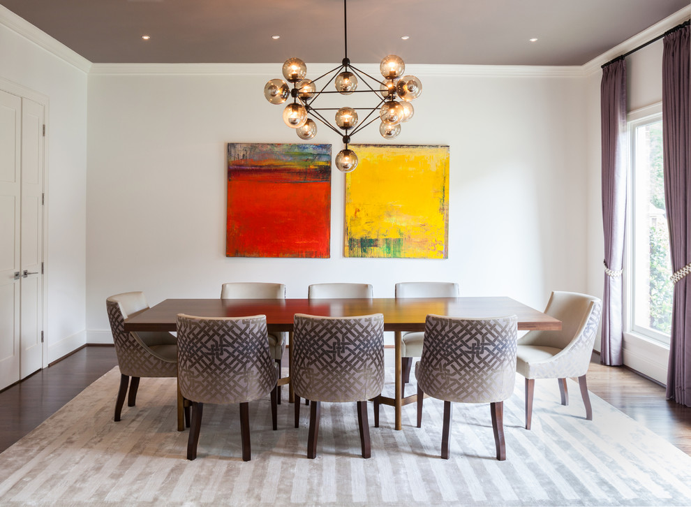 Example of a trendy dining room design in Houston with white walls