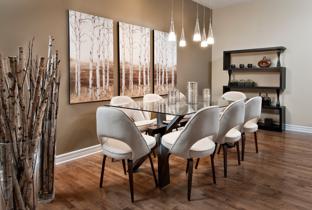 Example Of A Minimalist Medium Tone Wood Floor Dining Room Design In Ottawa With Beige Walls