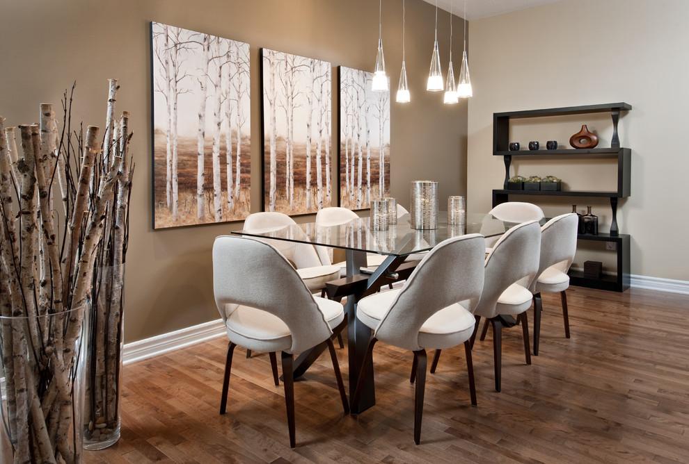 Example of a minimalist medium tone wood floor dining room design in Ottawa with beige walls
