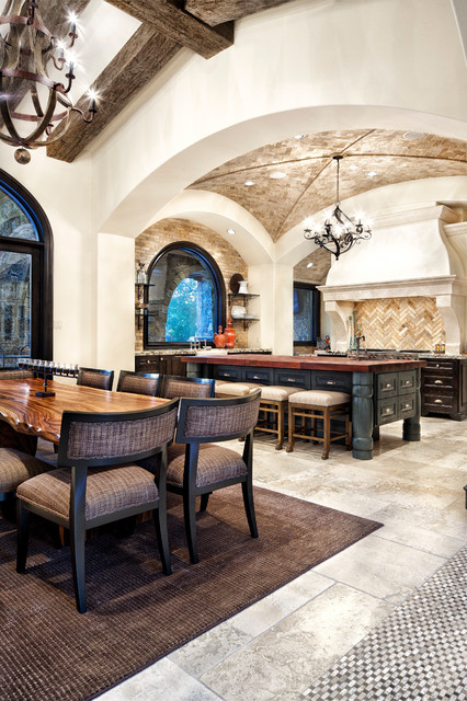 Tuscan great room photo in Austin with white walls
