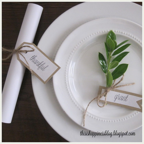 leaf with printed place cards on white plates