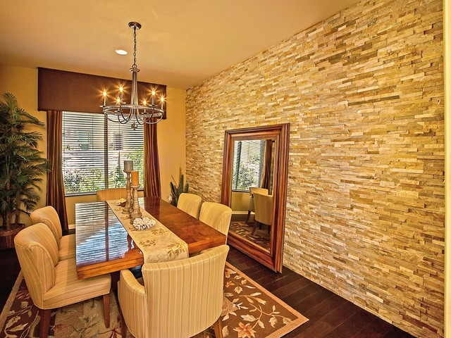 Stone wall dining room houzz dining room traditional dark wood floor dining room idea in los angeles with yellow walls sxxofo