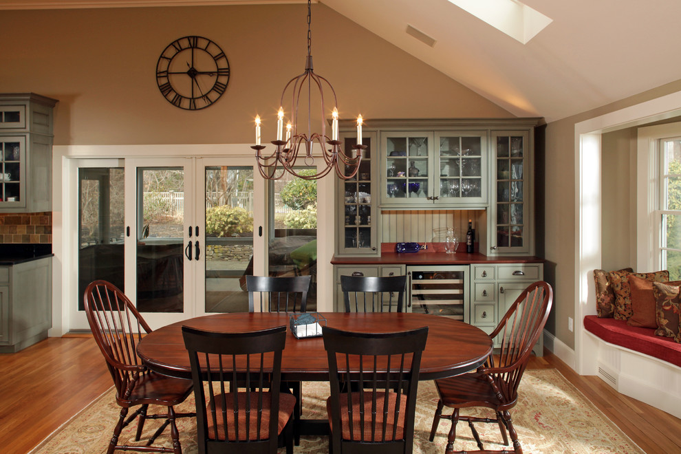 Inspiration for a timeless light wood floor kitchen/dining room combo remodel in Boston with beige walls