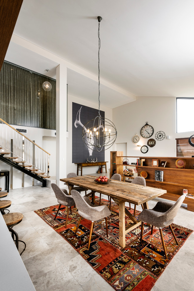 Inspiration for a contemporary kitchen/dining room combo remodel in Perth with white walls and no fireplace