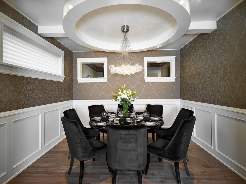 Example of a transitional dark wood floor enclosed dining room design in Edmonton with brown walls