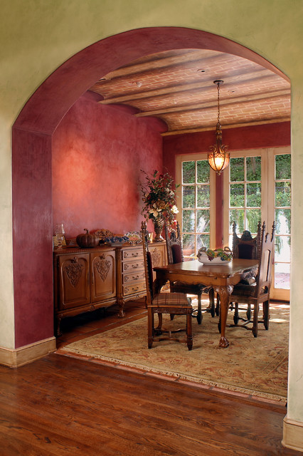 The dining room vaulted ceiling for Traditional red dining room
