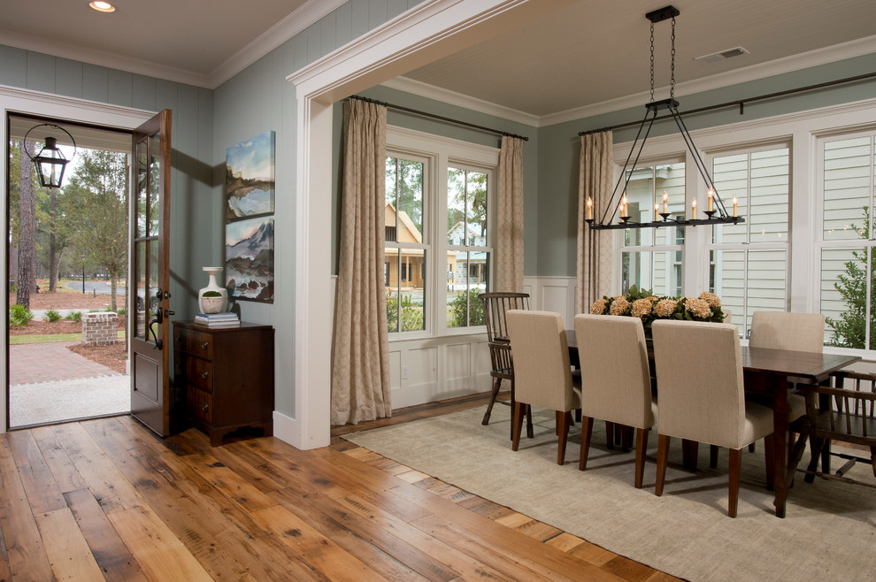 Inspiration for a mid-sized timeless medium tone wood floor and brown floor great room remodel in Charleston with blue walls and no fireplace