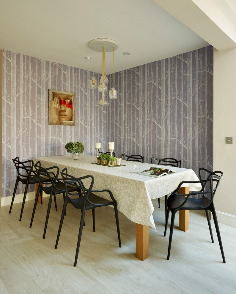 Large transitional light wood floor dining room photo in Berkshire with purple walls and no fireplace