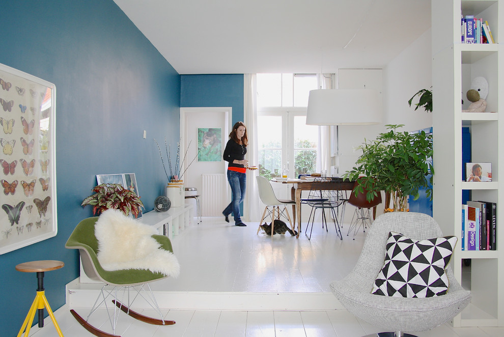 Dining room - eclectic white floor dining room idea in Amsterdam