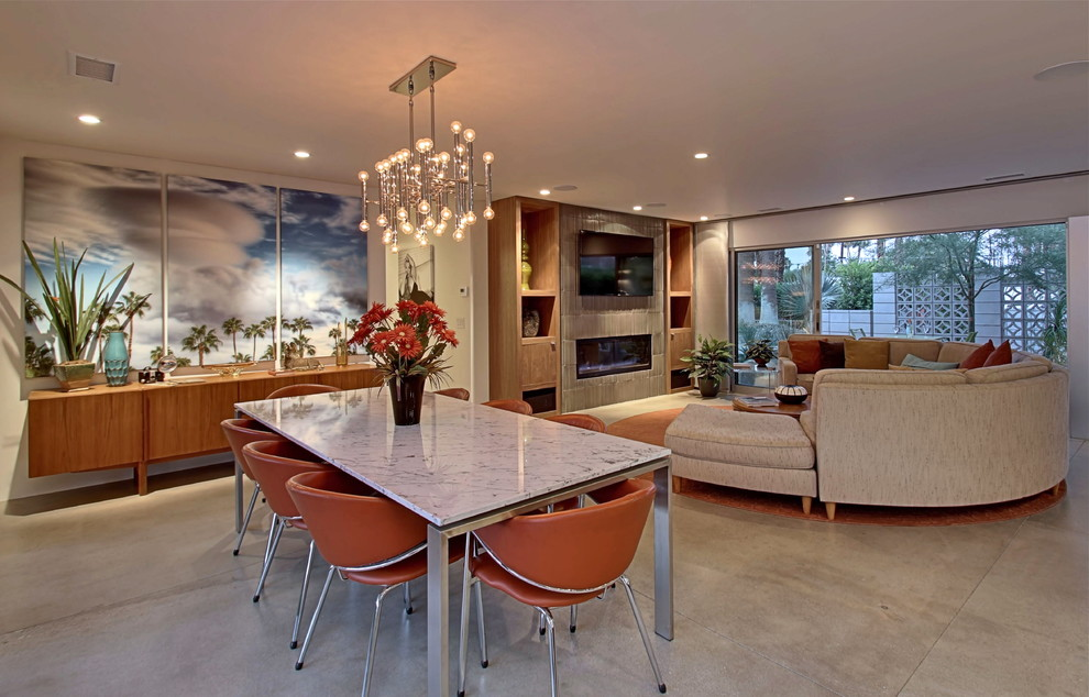 Example of a mid-sized 1950s concrete floor great room design in Los Angeles with white walls
