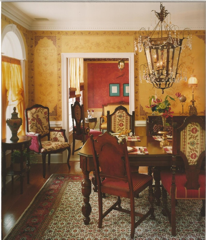 Inspiration for a mid-sized timeless medium tone wood floor enclosed dining room remodel in Philadelphia with yellow walls