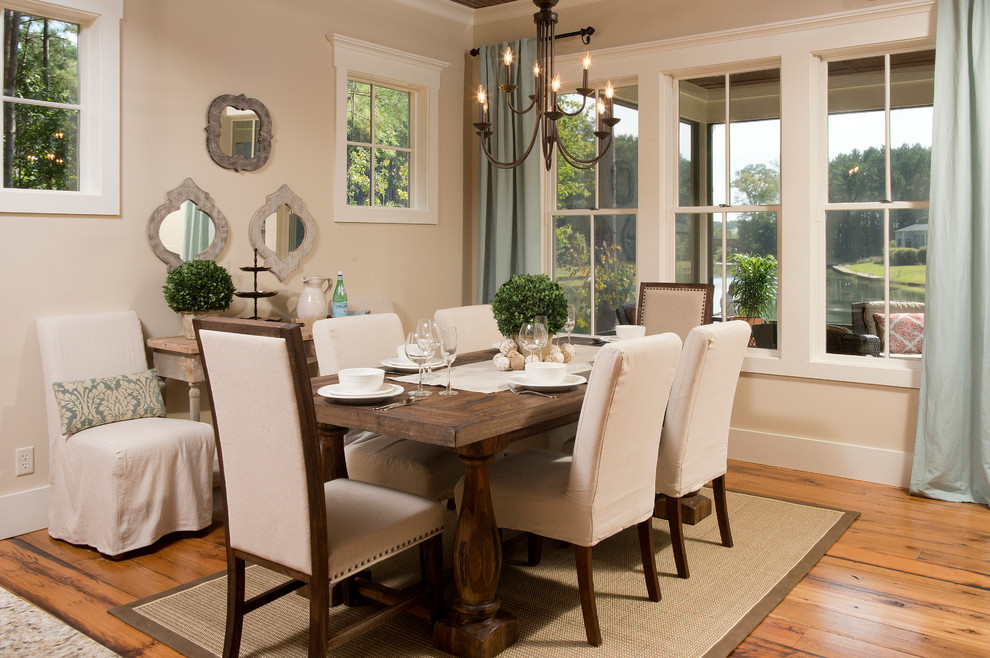 Example of a mountain style medium tone wood floor dining room design in Charleston with beige walls