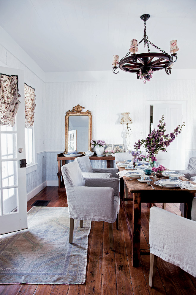 Example of a cottage chic dark wood floor dining room design in Los Angeles