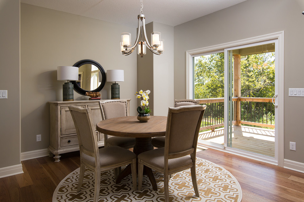 Kitchen/dining room combo - mid-sized traditional light wood floor kitchen/dining room combo idea in Kansas City with gray walls