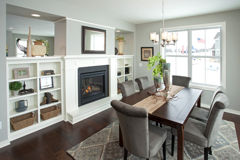 Elegant dark wood floor dining room photo in Minneapolis with gray walls and a two-sided fireplace