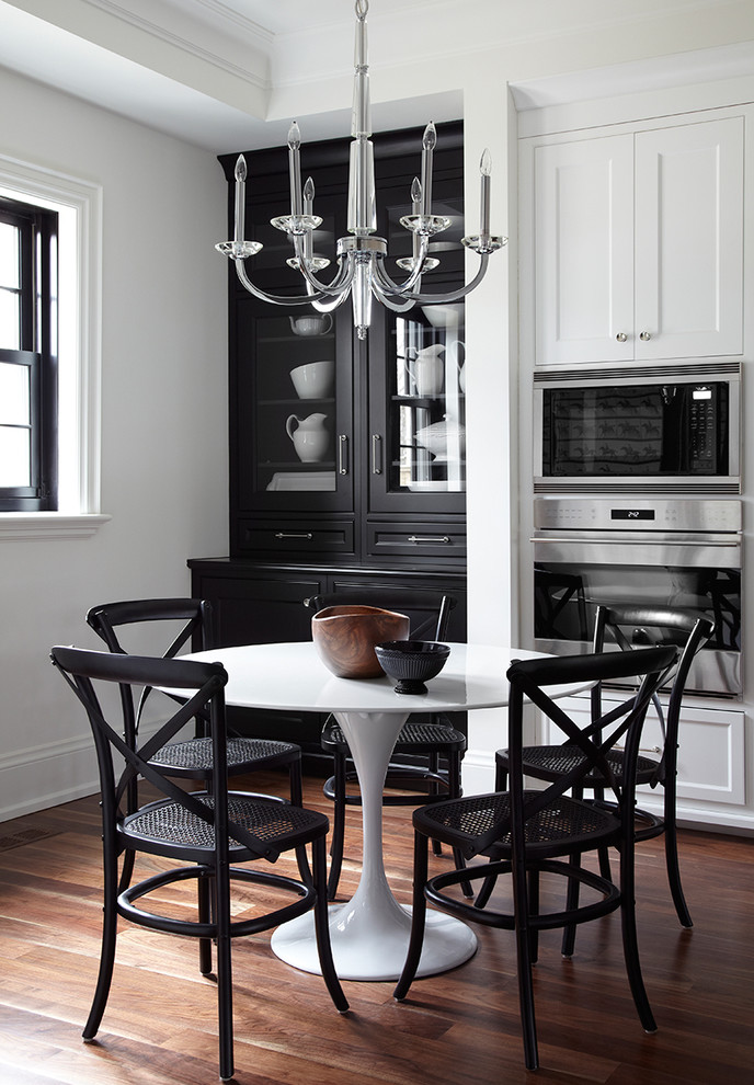 Example of a transitional dark wood floor kitchen/dining room combo design in Toronto with white walls