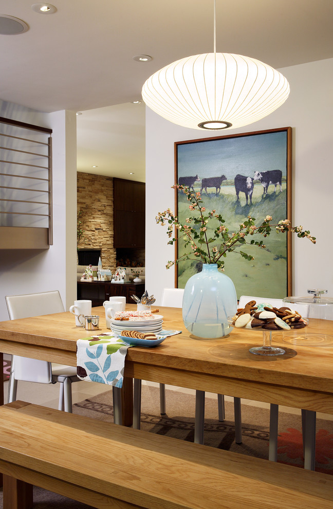 Example of a mid-century modern dining room design in San Francisco with white walls