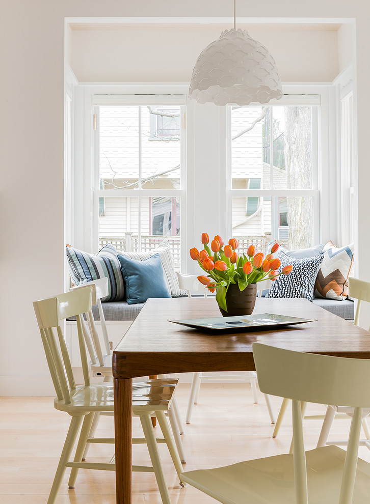 Dining room - scandinavian light wood floor dining room idea in Boston with white walls