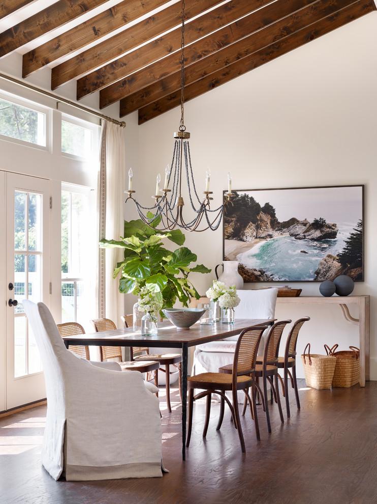 Dining room - transitional medium tone wood floor dining room idea in Atlanta with white walls