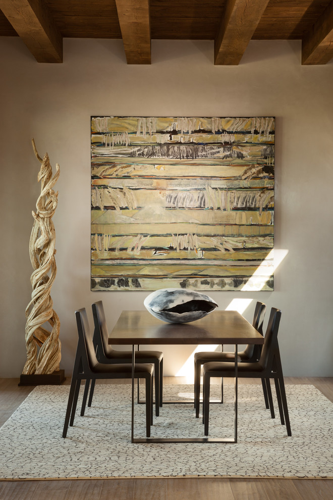 Dining room - southwestern light wood floor dining room idea in Albuquerque with white walls