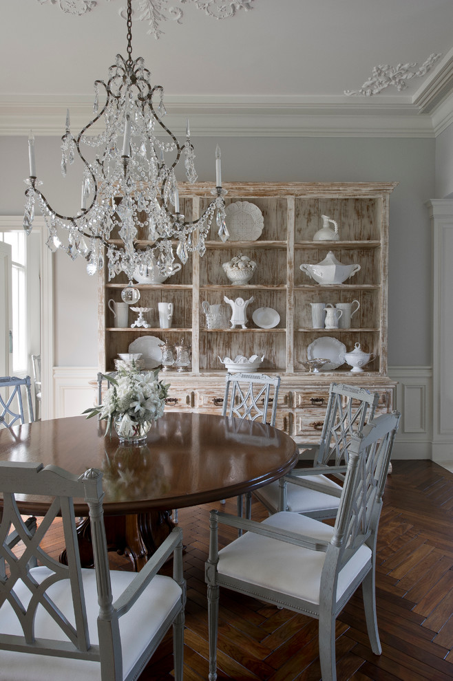 Enclosed dining room - mid-sized traditional dark wood floor enclosed dining room idea in Miami with gray walls