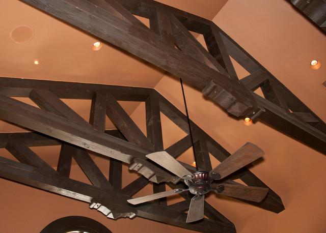 Timber Accents in San Antonio Custom Home mediterranean-dining-room