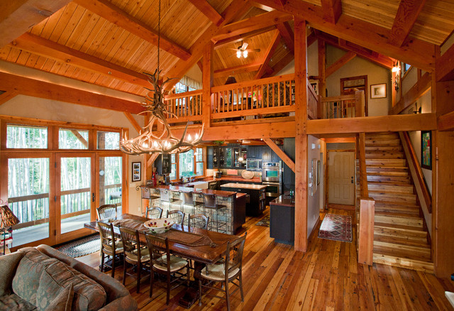 Timber frame in the mountains rustic dining room for Timber framed house plans