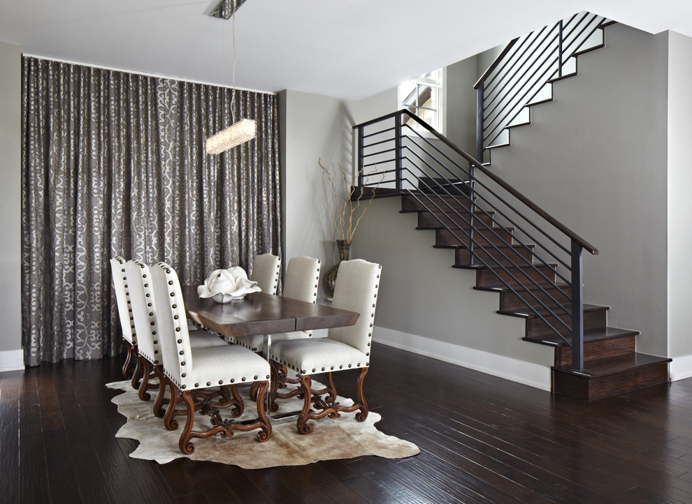 Inspiration for a contemporary dark wood floor dining room remodel in Austin with gray walls