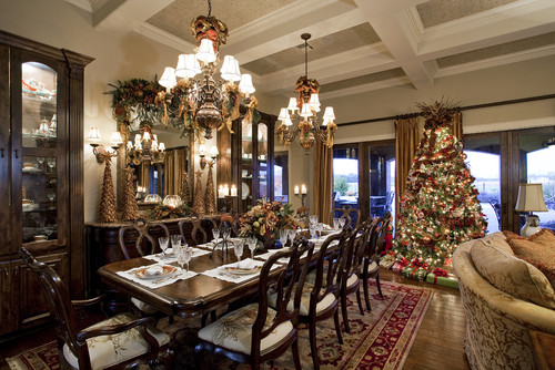 dining room with a set table and a Christmas tree on one end