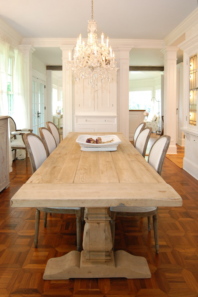 Dining room - traditional medium tone wood floor and brown floor dining room idea in New York