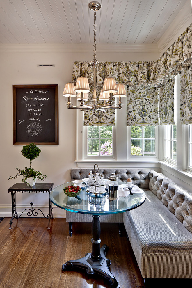 Inspiration for a timeless dark wood floor and brown floor dining room remodel in Other with white walls