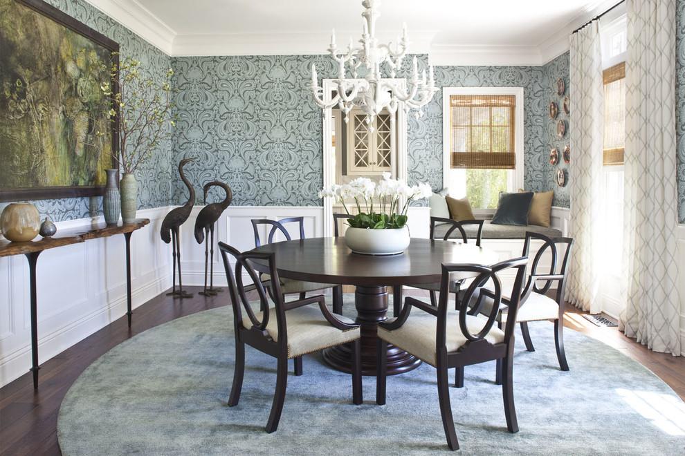 Ornate dark wood floor enclosed dining room photo in Los Angeles with blue walls