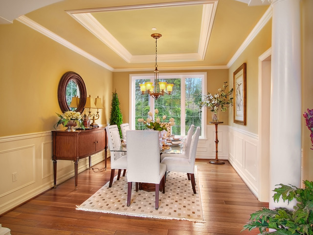Inspiration For A Timeless Dining Room Remodel In Seattle With Yellow Walls