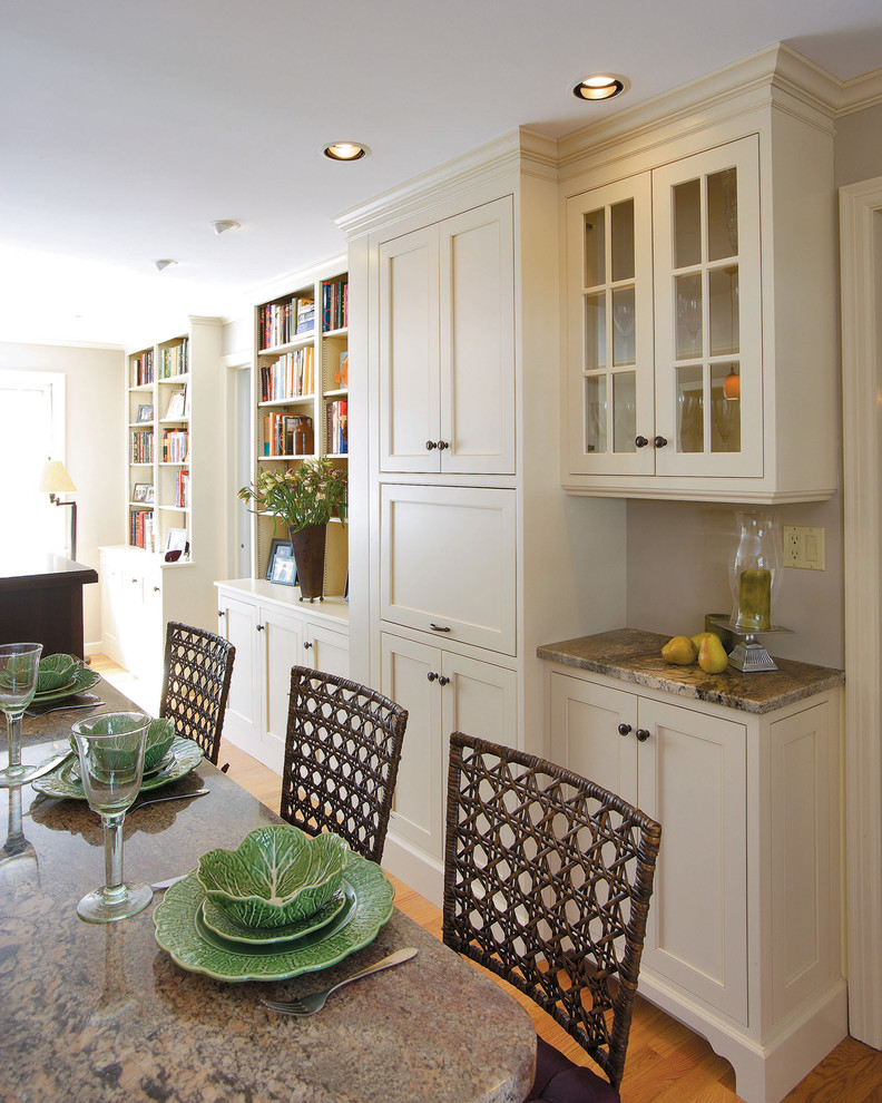 Elegant medium tone wood floor dining room photo in Other with gray walls
