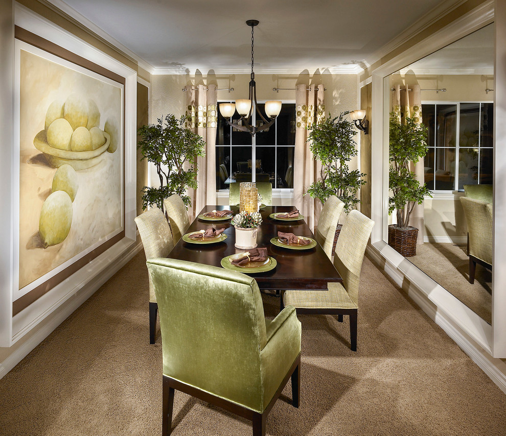Elegant carpeted enclosed dining room photo in Other with beige walls