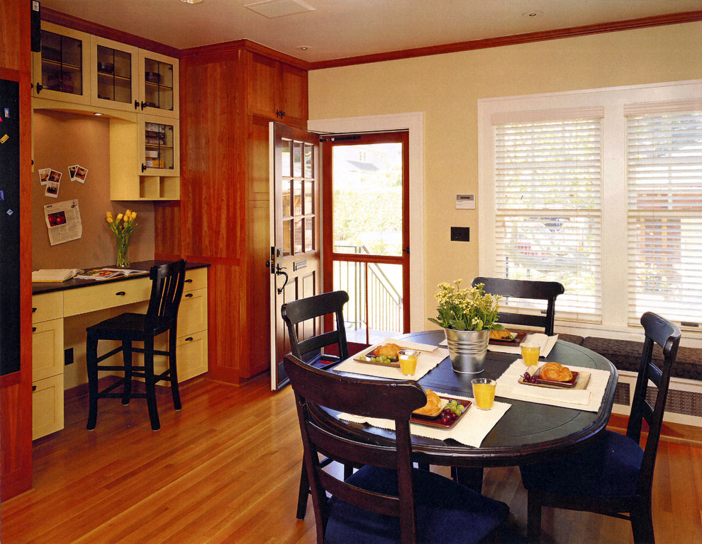 Inspiration for a timeless medium tone wood floor dining room remodel in Seattle with beige walls
