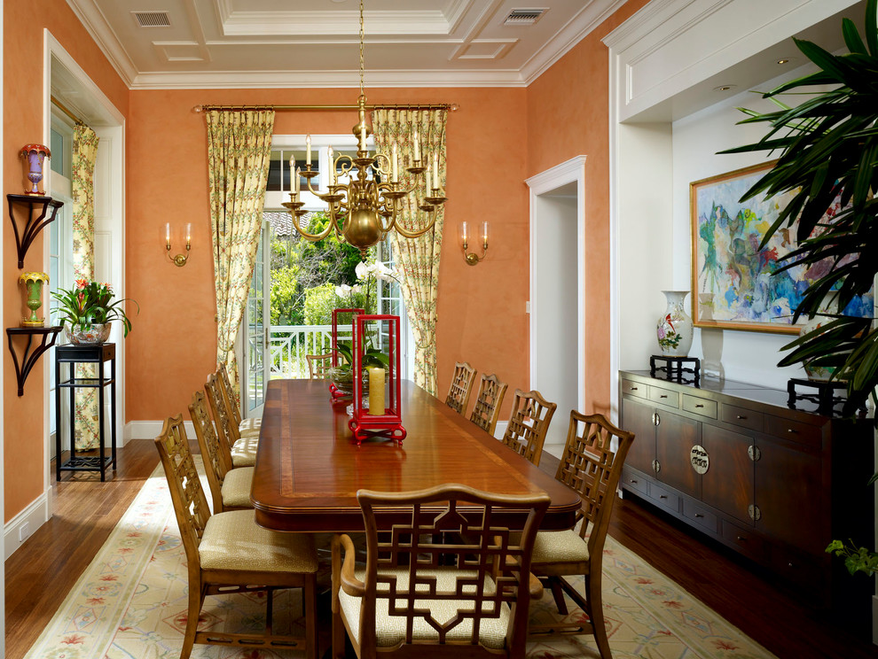 Example of a classic dining room design in Other with orange walls
