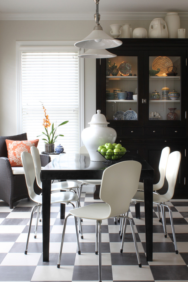 Inspiration for a timeless ceramic floor and multicolored floor dining room remodel in Chicago with beige walls