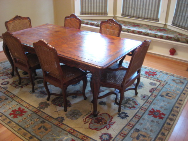 Traditional dining room with tibetan area rug for Dining room rugs 9x12