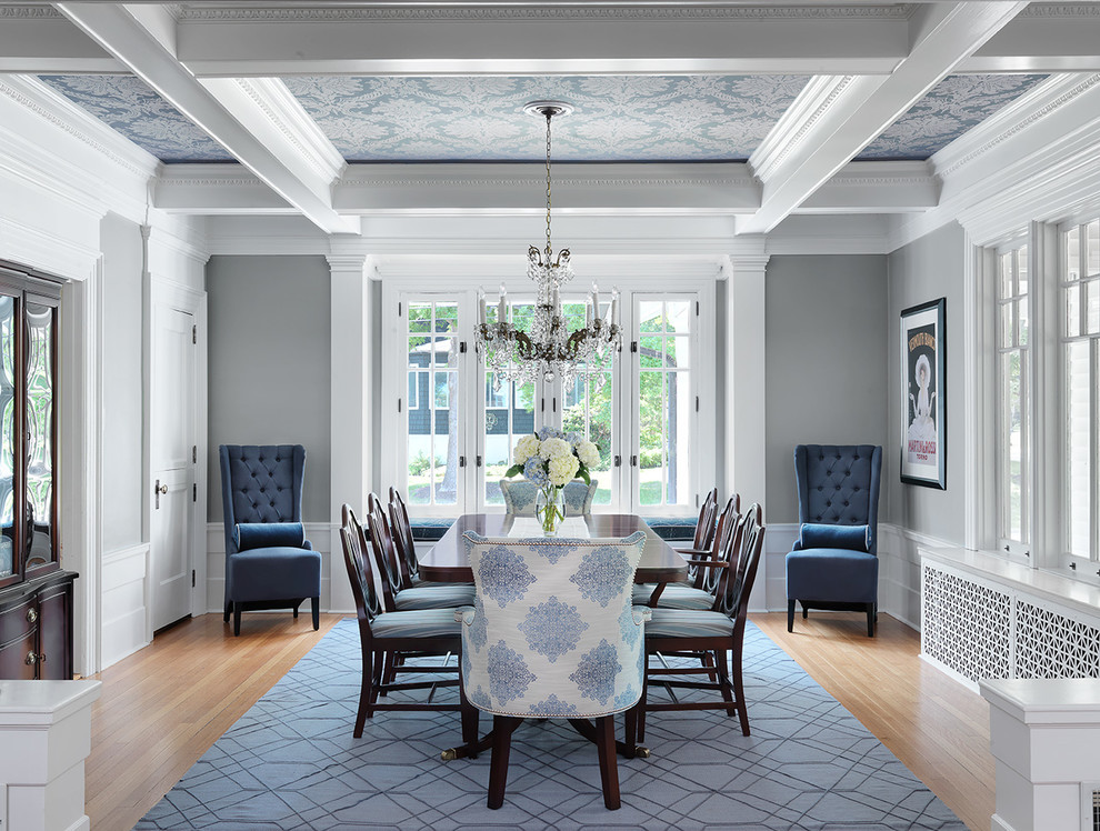 Inspiration for a timeless light wood floor and beige floor dining room remodel in St Louis with gray walls