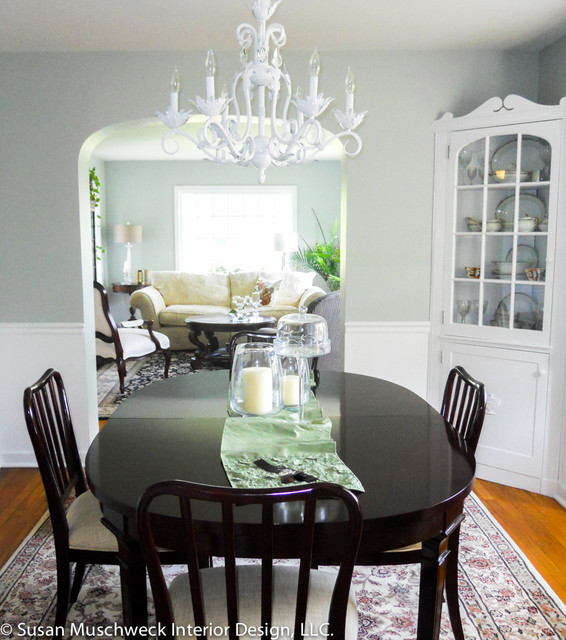 room with white chandelier and dark table traditional dining room